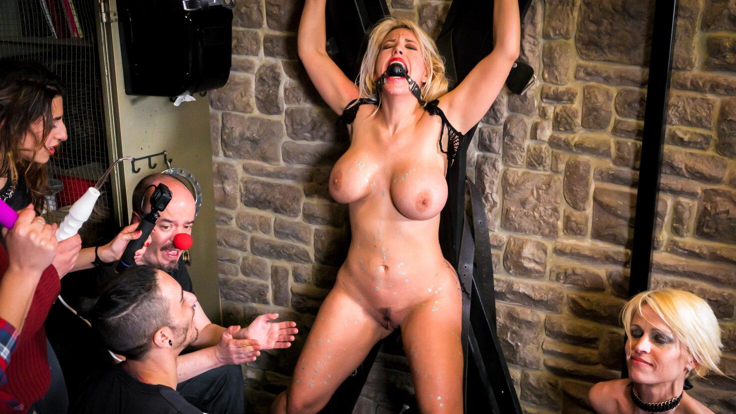 Curvy Blondie Fesser dominated in BDSM group scene