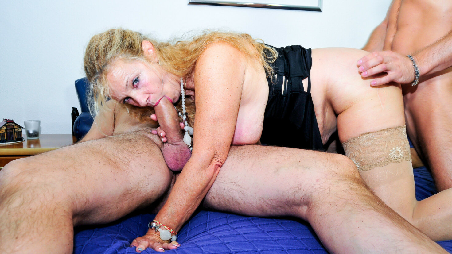 Mature blondie fucked hard in German threesome