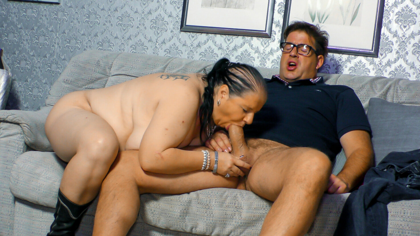 Mature BBW granny is sucking and riding a huge penis