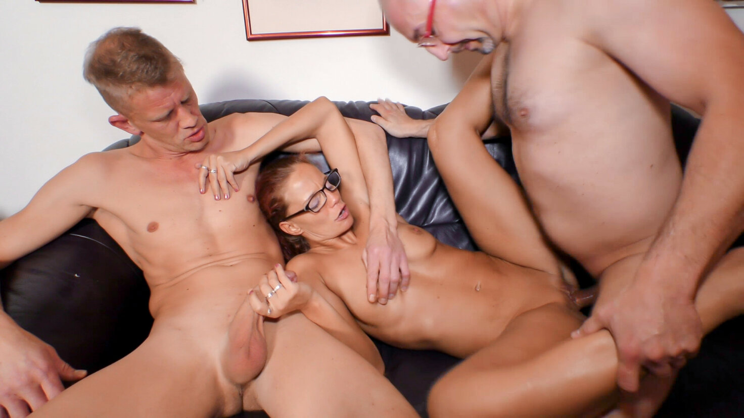 Mature German chick gets two cumloads on tits in steamy MMF threesome