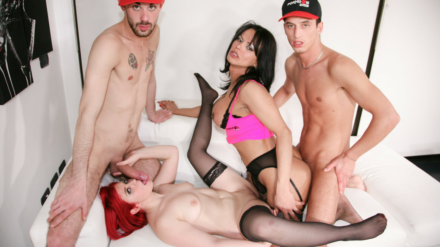 Naughty foursome with sexy Latina tranny and Italian redhead fucking studs