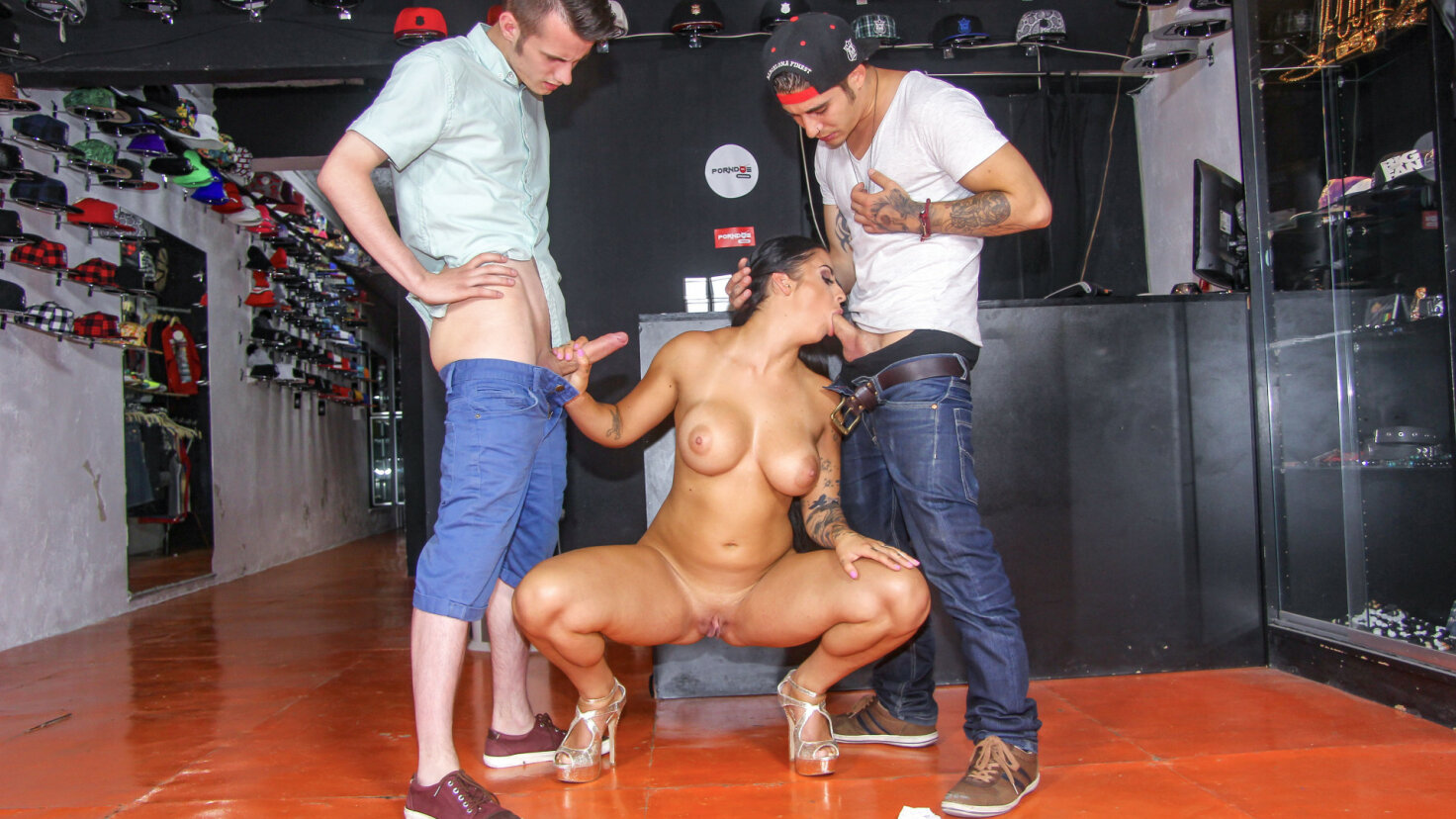 Busty British brunette gets shared by two lucky dudes in hardcore threesome