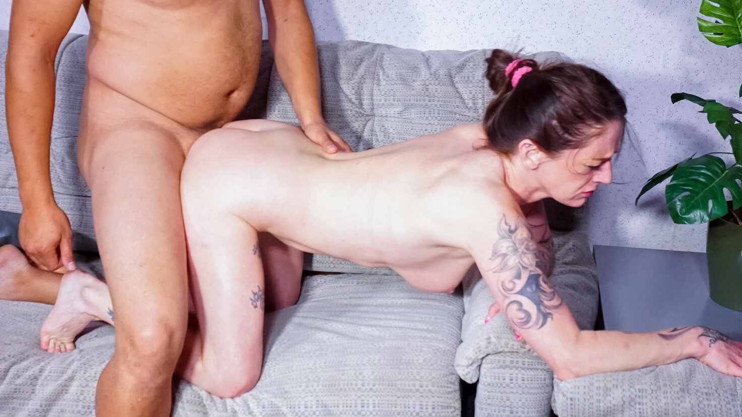 Busty brunette German housewife enjoys riding and sucking big cock